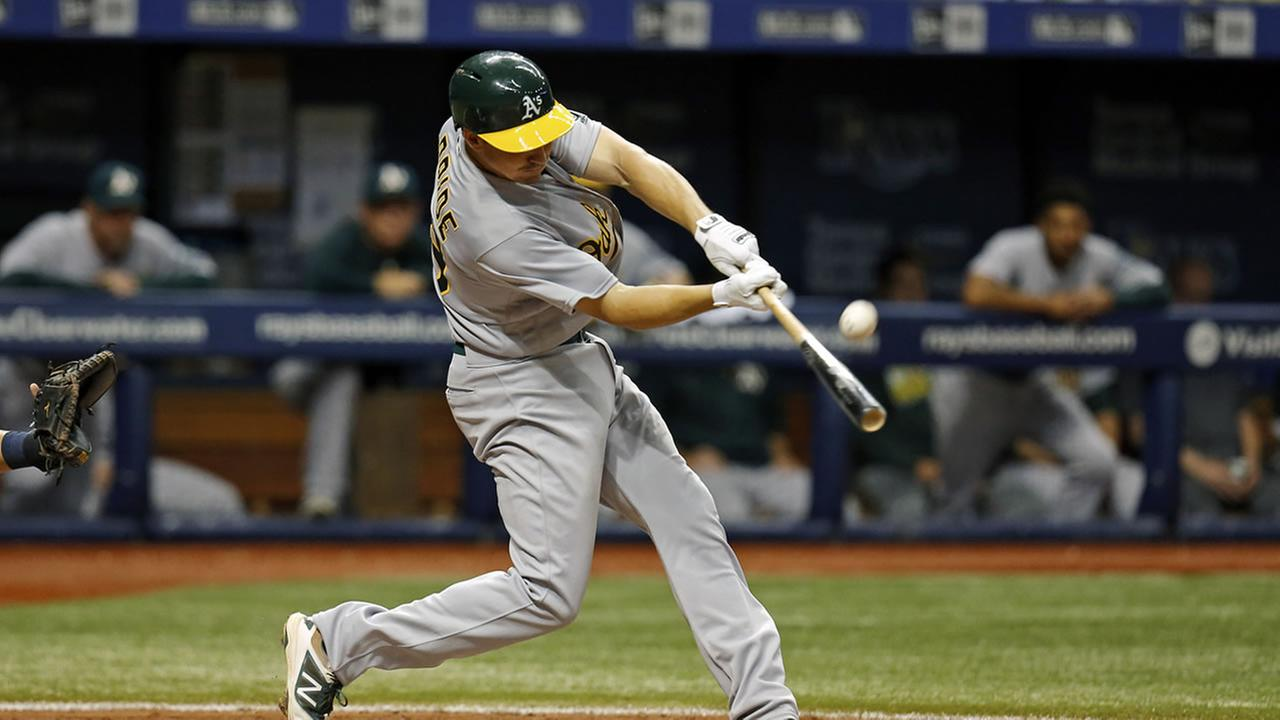 Oakland Athletics Matt McBride swings during the sixth inning of a baseball game against the Tampa Bay Rays Saturday, May 14, 2016, in St. Petersburg, Fla.