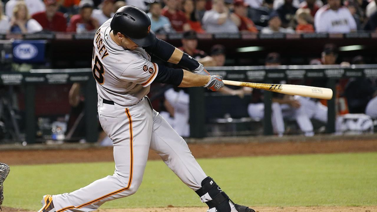 San Francisco Giants Buster Posey connects for a two-run double against the Arizona Diamondbacks during the ninth inning of a baseball game Saturday, May 14, 2016, in Phoenix.