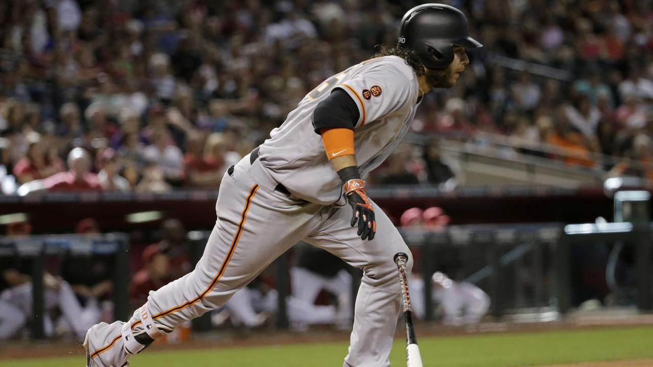 Giants Brandon Crawford follows through on an RBI double against the Diamondbacks  during a game on Sunday, May 15, 2016, in Phoenix. (AP Photo/Matt York)