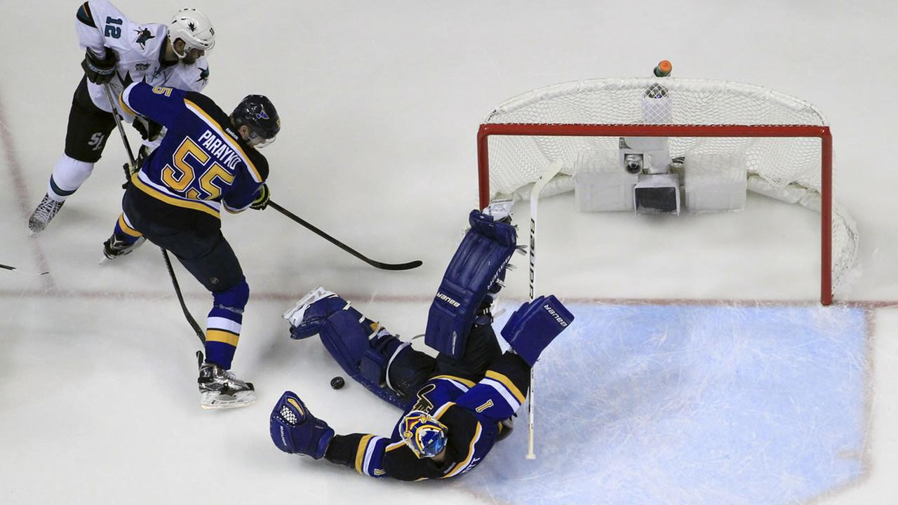 Blues Elliott makes the save as Sharks Marleau and Blues Parayko battle for the puck during Game 1 of the Western Conference Finals on May 15, 2016, in St. Louis. (AP Photo)