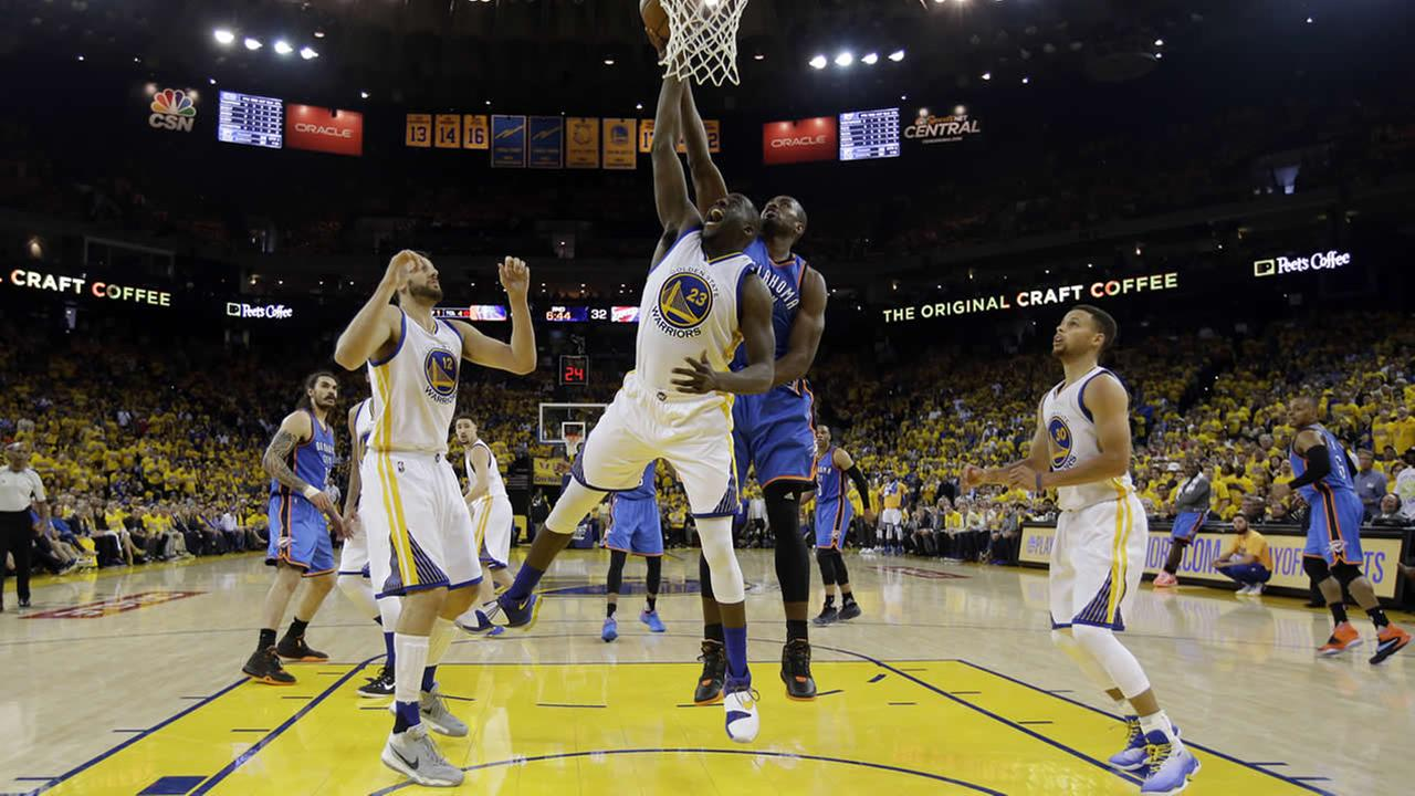 Warriors Draymond Green fights for a rebound against Thunders Serge Ibaka during Game 1 of the Western Conference Finals on May 16, 2016, in Oakland, Calif. (AP Photo)