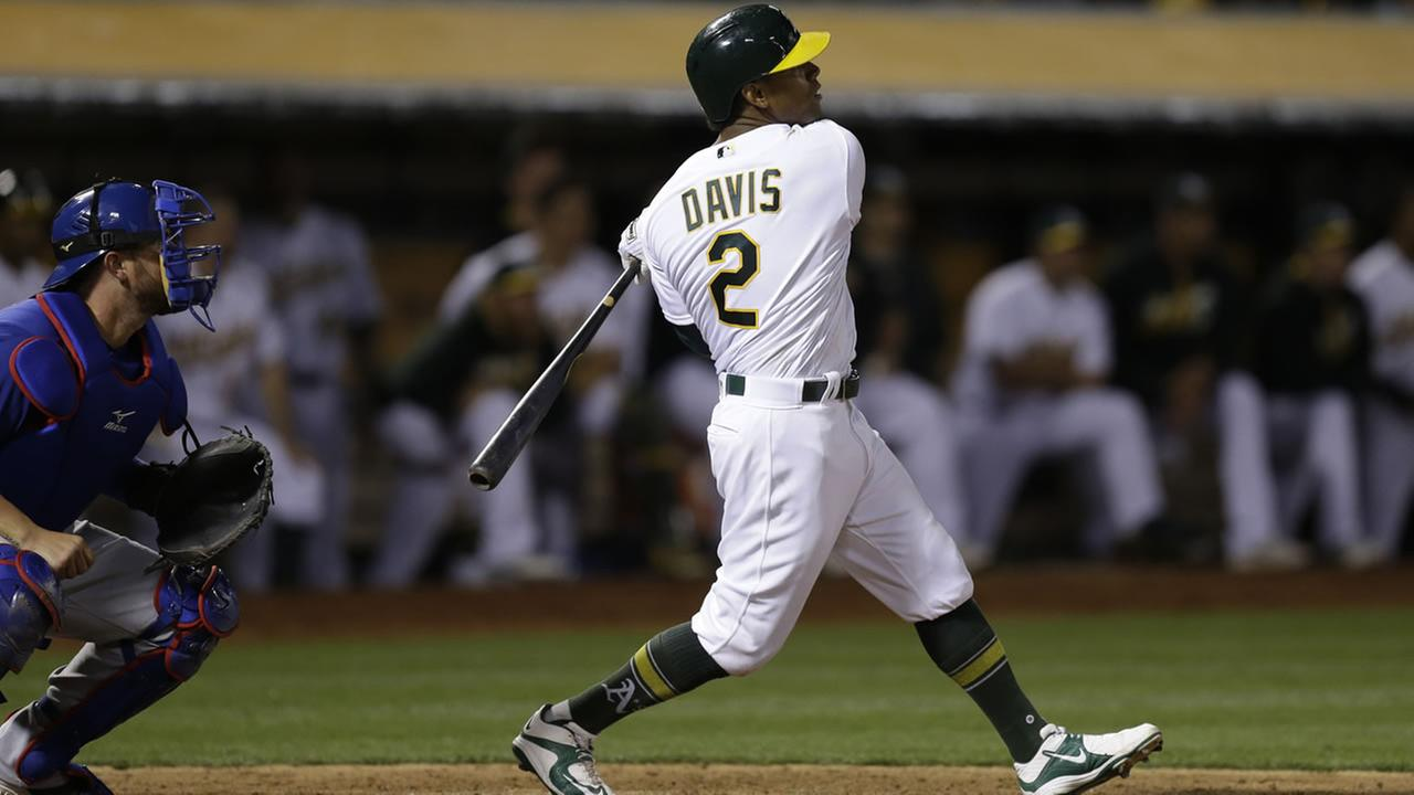 Athletics Khris Davis follows through on a walk-off grand slam against the Texas Rangers during the ninth inning of a baseball game on May 17, 2016, in Oakland, Calif.  (AP Photo)
