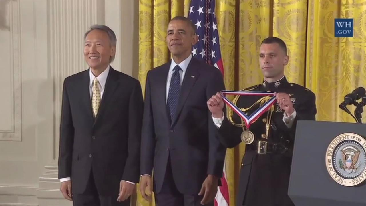 This image shows a Bay Area scientists receiving a National Science Medal from President Barack Obama.