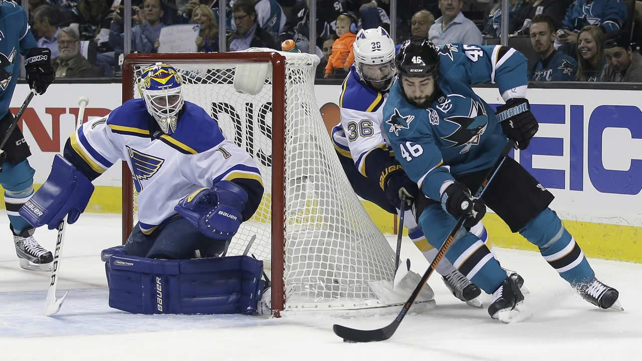 Sharks Roman Polak skates past Blues Troy Brouwer during Game 3 of the NHL hockey Stanley Cup Western Conference finals on May 19, 2016, in San Jose, Calif. (AP Photo)
