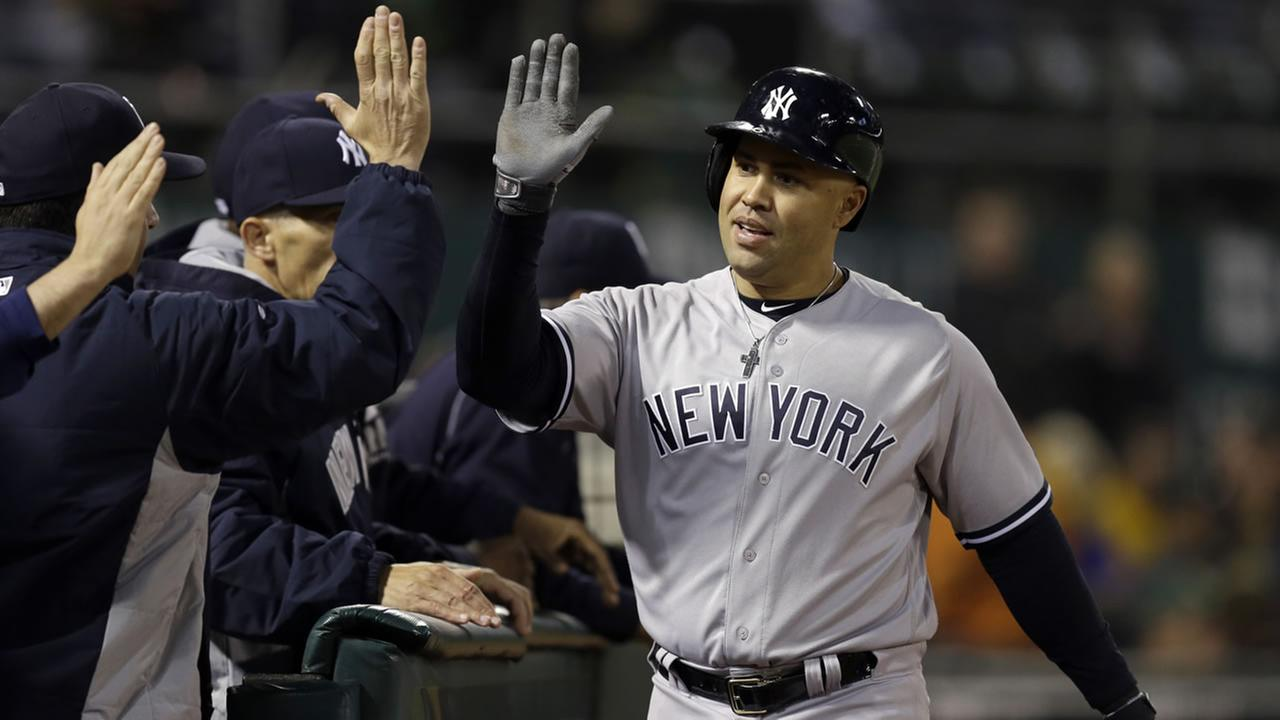 Yankees Carlos Beltran is congratulated after hitting a two-run home run off Athletics Fernando Rodriguez during a game on May 19, 2016 in Oakland, Calif. (AP Photo)