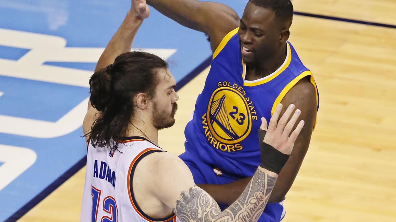 Warriors Draymond Green fouls Thunders Steven Adams in the first half in Game 3 of the NBA basketball Western Conference finals in Oklahoma City on May 22, 2016. (AP Photo)