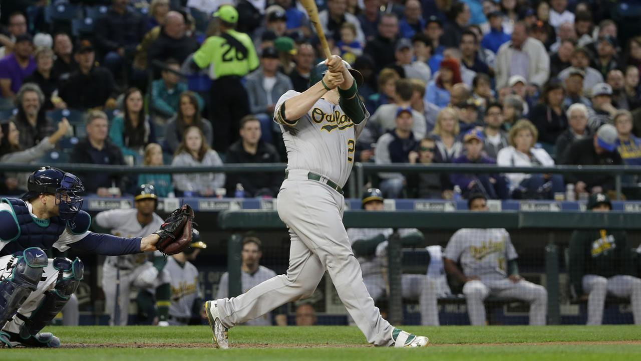 Athletics Stephen Vogt hits a solo home run in the seventh inning of a baseball game against the Seattle Mariners, Monday, May 23, 2016, in Seattle. (AP Photo/Ted S. Warren)