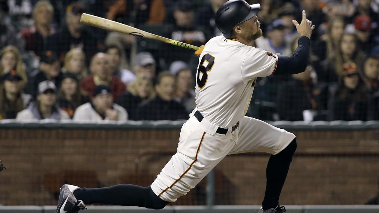 Hunter Pence hits a double to score Brandon Belt for the winning run against the Padres during the ninth inning of a game in San Francisco, Monday, May 23, 2016. (AP Photo)