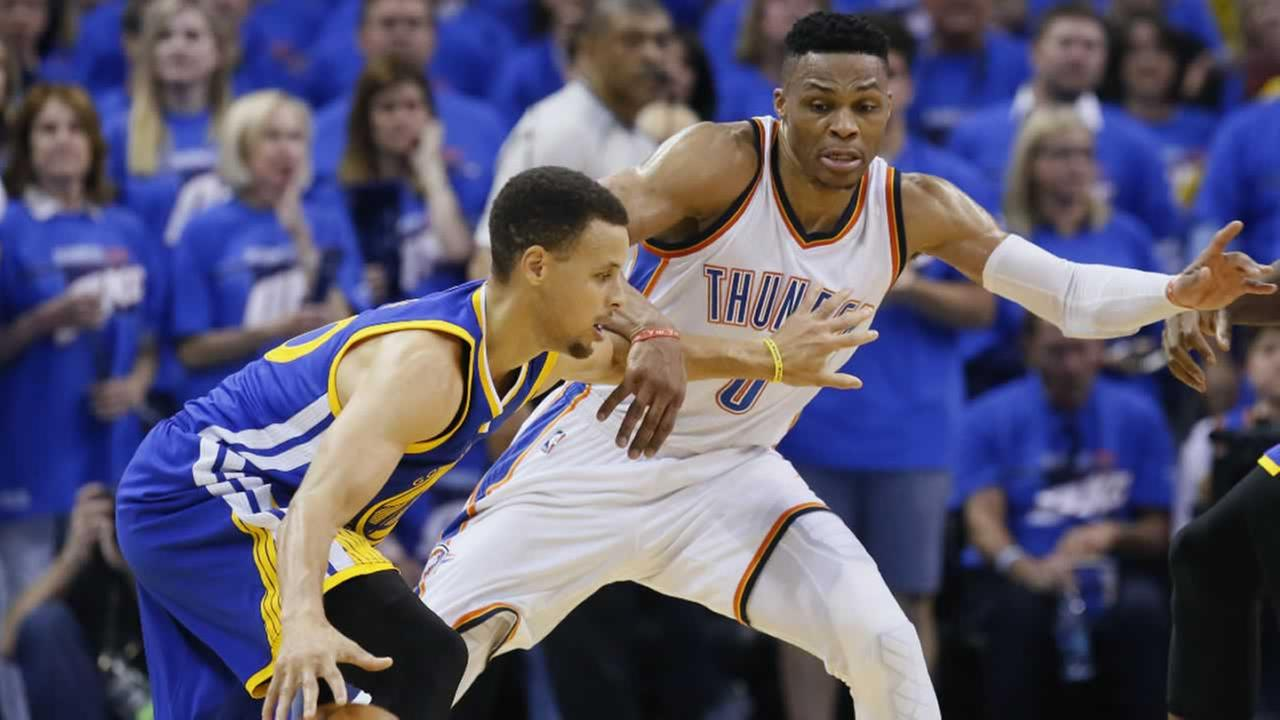 Warriors guard Stephen Curry tries to drive around Thunder guard Russell Westbrook in Game 3 of the NBA basketball Western Conference finals in Oklahoma City, Sunday, May 22, 2016.
