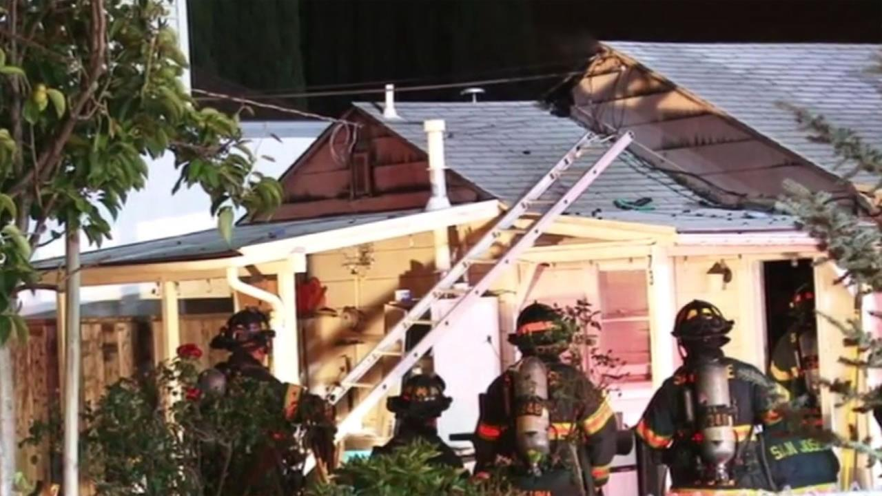 Six people escaped from this burning home on Pala Avenue in San Jose, Calif. on Tuesday, May 24, 2016.