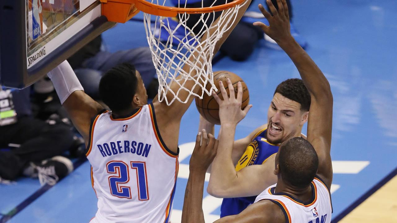 Warriors Klay Thompson is fouled by Thunder Andre Roberson during Game 3 of the NBA basketball Western Conference finals in Oklahoma City on May 22, 2016. (AP Photo/Sue Ogrocki)