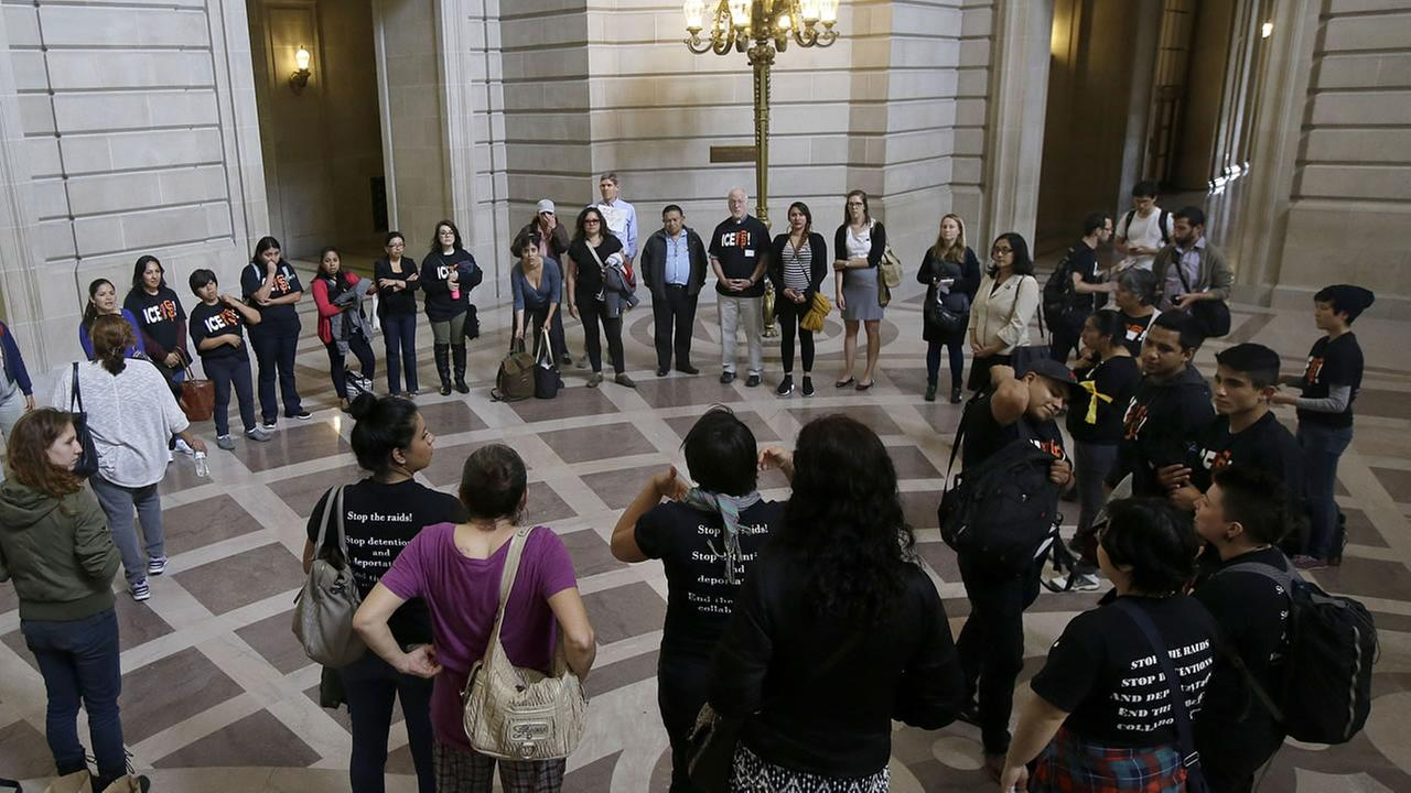 A group calling for San Francisco to maintain its strict sanctuary protections in the country illegally gathers before a Board of Supervisors meeting at City Hall on May 24, 2016.