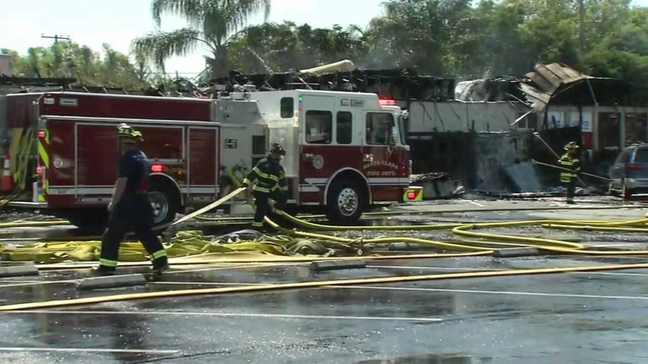 A five-alarm fire burned eight businesses in a strip mall in Santa Clara, Calif. on Wednesday, May 25, 2016.