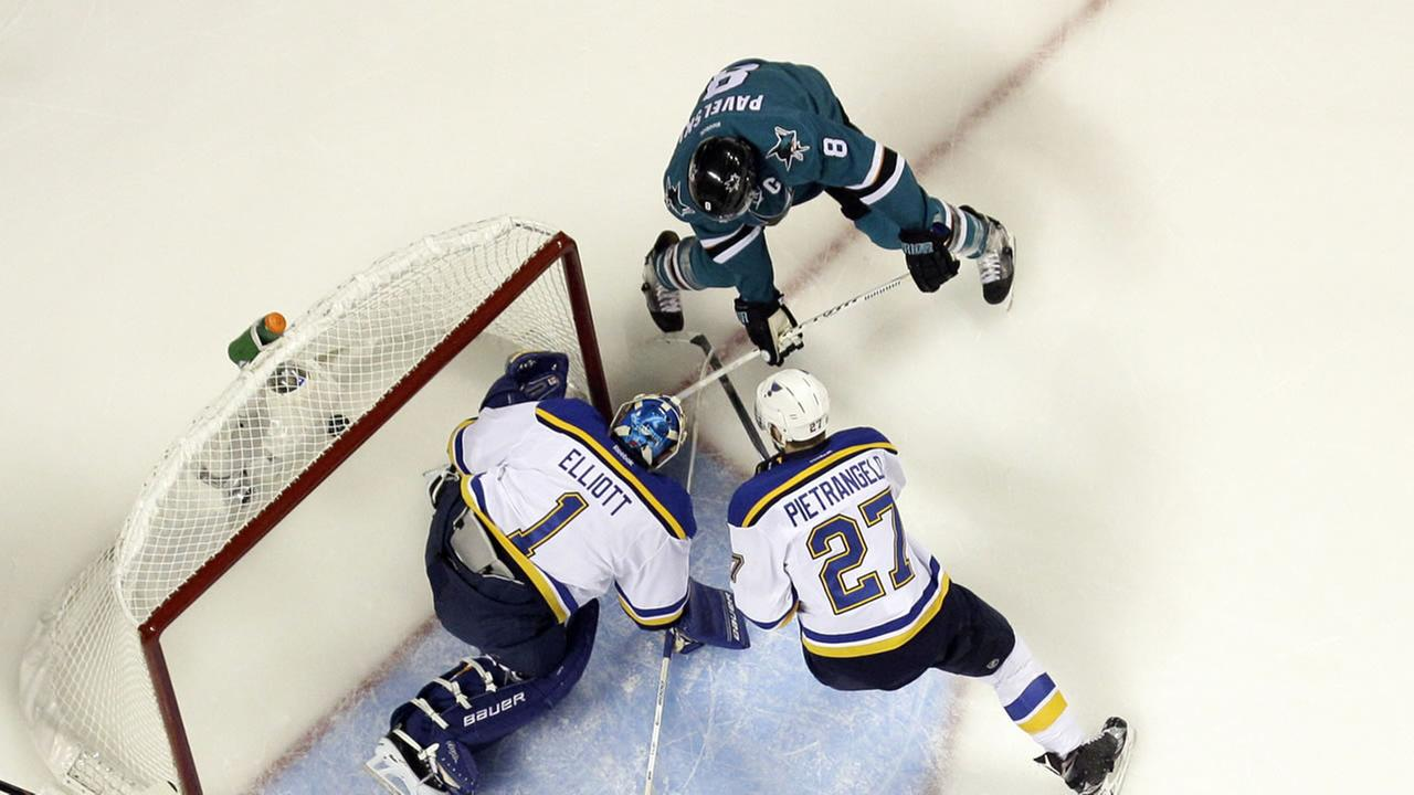 San Jose Sharks Joe Pavelski (8) scores past St. Louis Blues goalie Brian Elliott (1) and the Blues Alex Pietrangelo (27) in Game 6 of the NHL Western Conference Finals.