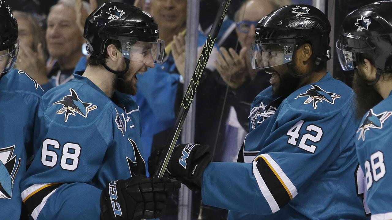 San Jose Sharks Joel Ward (42) celebrates his goal with teammate Melker Karlsson (68) in Game 6 of the NHL hockey Stanley Cup Western Conference finals.