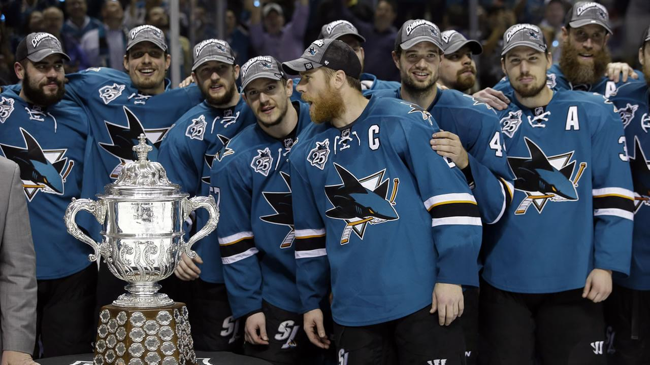 The San Jose Sharks pose for photos after a 5-2 win over the St. Louis Blues during Game 6 of Western Conference finals Wednesday, May 25, 2016, in San Jose, Calif.