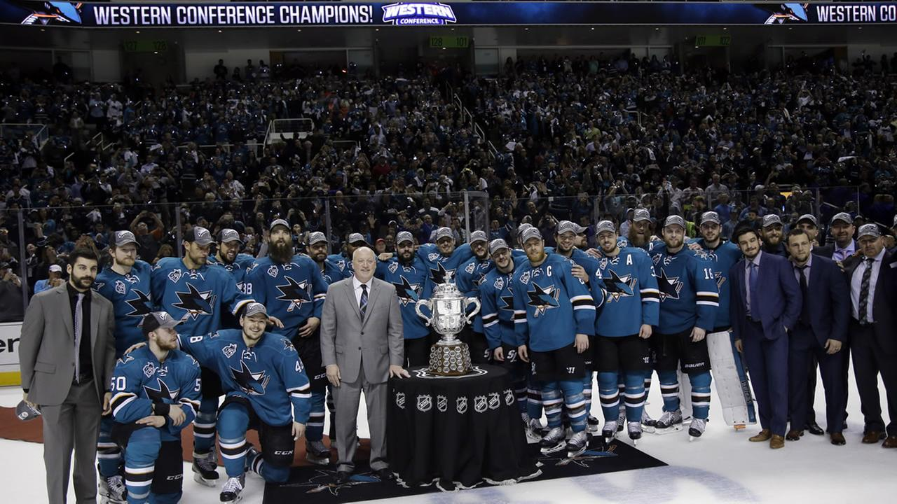 The San Jose Sharks pose for photos after a 5-2 win over the St. Louis Blues during Game 6 of Stanley Cup Western Conference finals Wednesday, May 25, 2016, in San Jose, Calif.AP Photo/Marcio Jose Sanchez