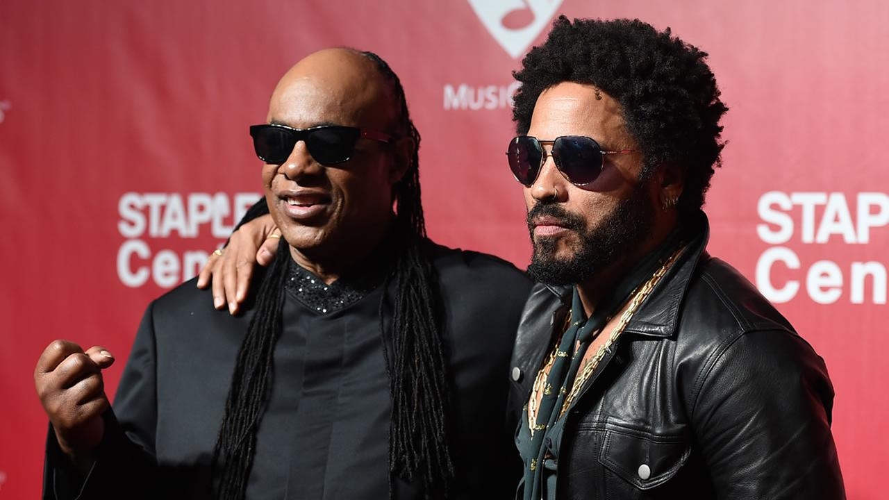 Stevie Wonder and Lenny Kravitz arrive at the MusiCares Person of the Year tribute honoring Lionel Richie at the Los Angeles Convention Center on Saturday, Feb. 13, 2016.