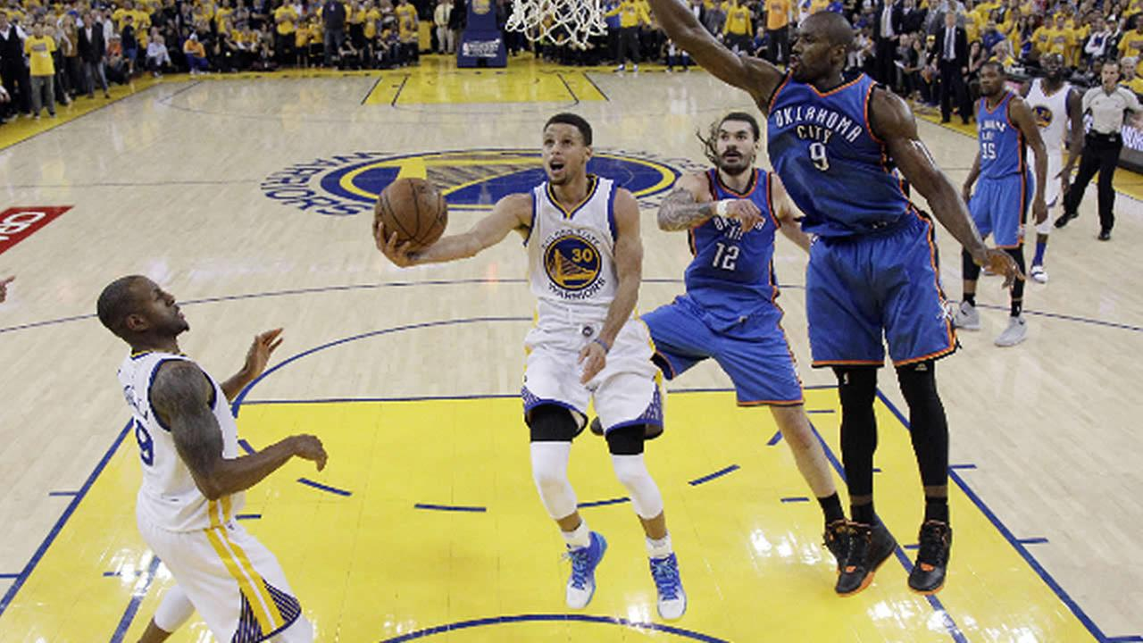 Warriors Stephen Curry drives past Oklahoma City Thunders Serge Ibaka and Steven Adams in Game 5 of the NBA basketball Western Conference finals Thursday, May 26, 2016, in Oakland, Calif.