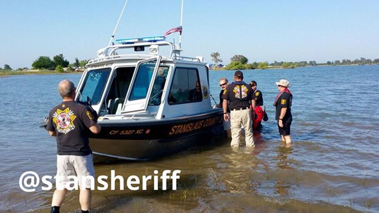 Stanislaus County deputies search the Woodward Reservoir in Oakdale, Calif.  after two Oakland teenagers went missing while swimming on May 28, 2016.
