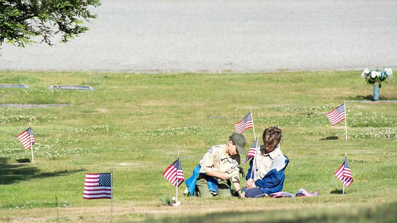 Local Boy Scouts place flags on veterans graves at Skylawn Memorial Park in San Mateo on Saturday, May 28 2016.