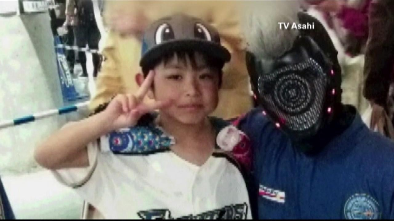 Rescuers are searching the woods in Japan for missing 7-year-old Yamato Tanooka.