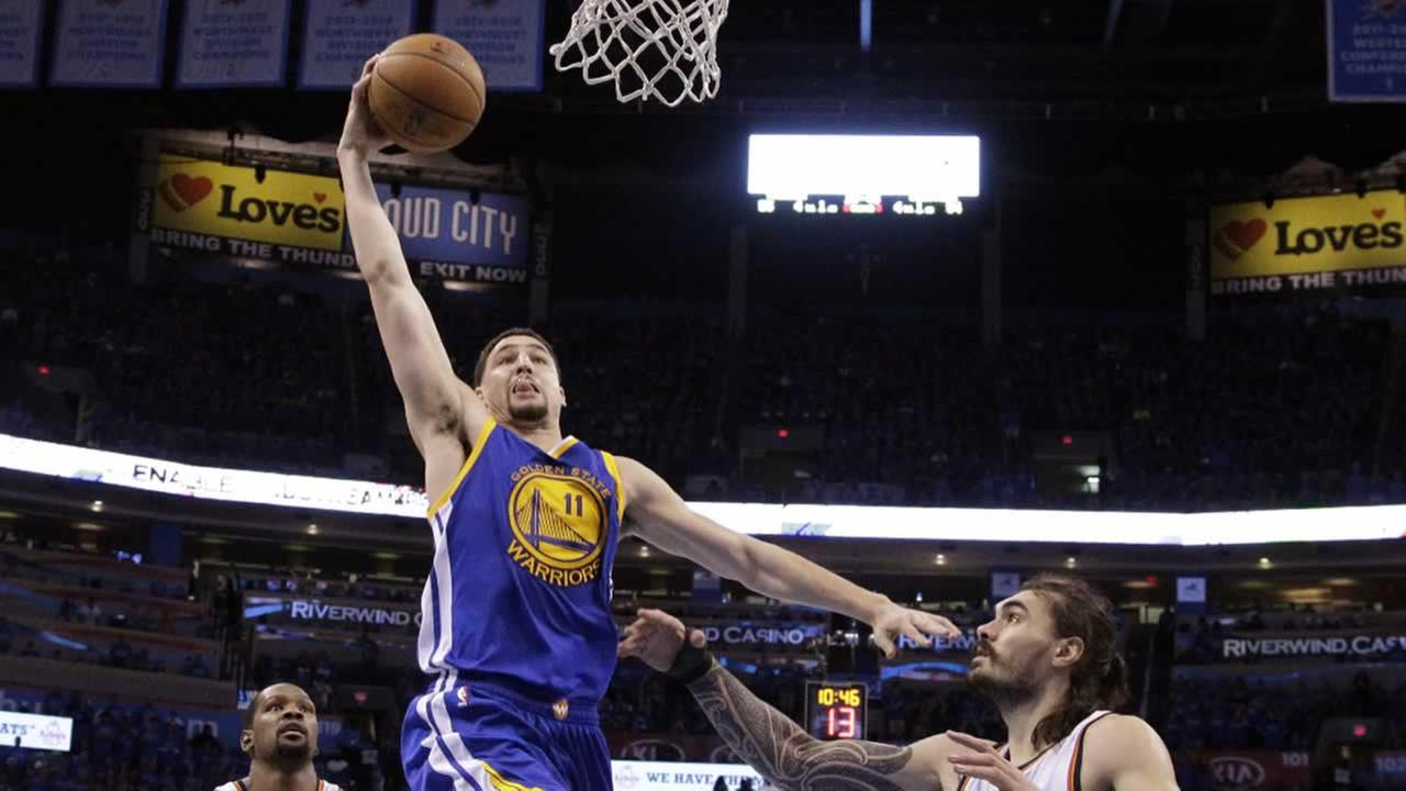 Warriors guard Klay Thompson shoots over Oklahoma City Thunder center Steven Adams in Oklahoma City, Saturday, May 28, 2016. The Warriors won 108-101.