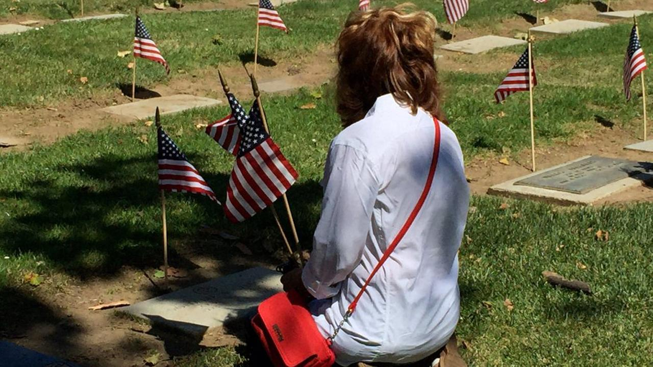 Woman grieves at Oak Hill Cemetery in San Jose, California, Monday, May 30, 2016.