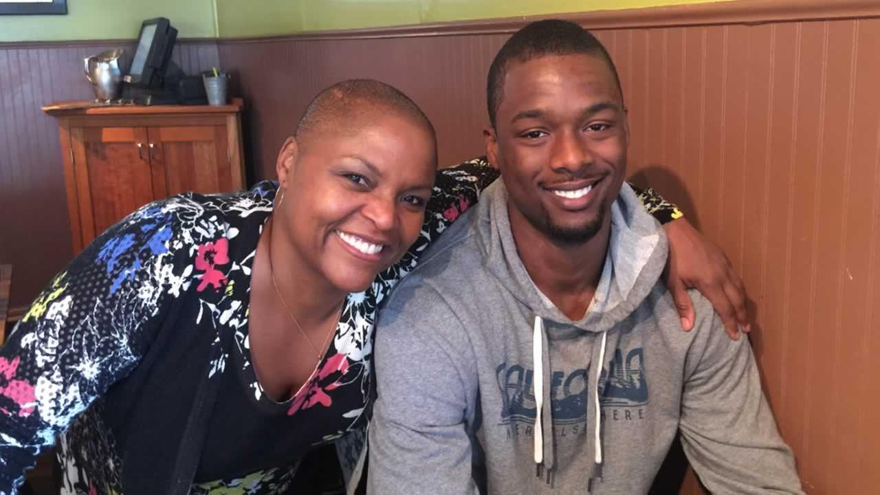 In this undated photo, Warriors player Harrison Barnes poses with restaurant owner Tanya Holland at Brown Sugar Kitchen in Oakland, Calif.