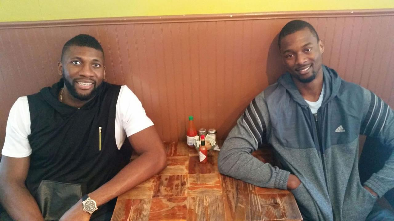 In this undated photo, Warriors players Festus Ezeli and Harrison Barnes eat at Brown Sugar Kitchen in Oakland, Calif.KGO-TV