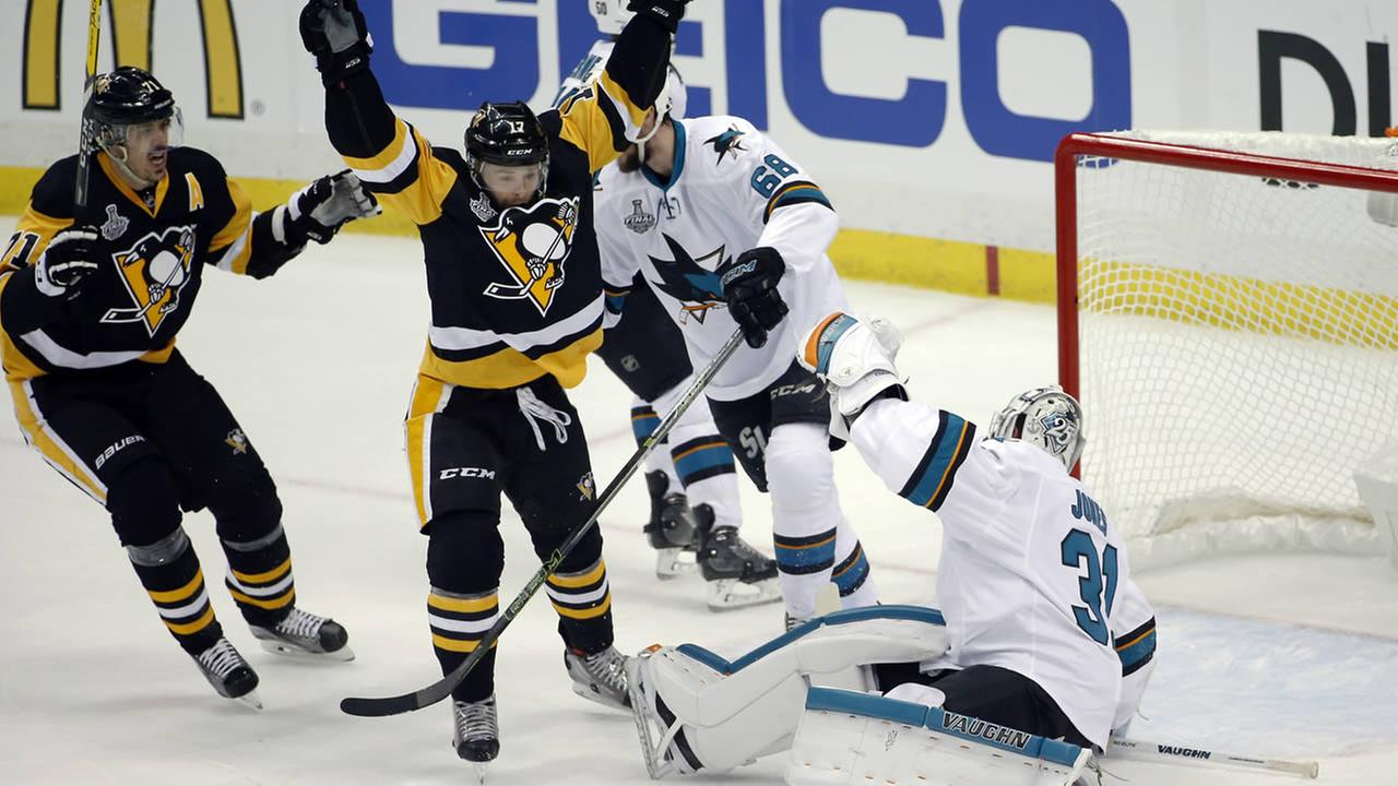 Pittsburgh Penguins Bryan Rust celebrates his goal against Sharks goalie Martin Jones during Game 1 of the Stanley Cup final series Monday, May 30, 2016, in Pittsburgh.