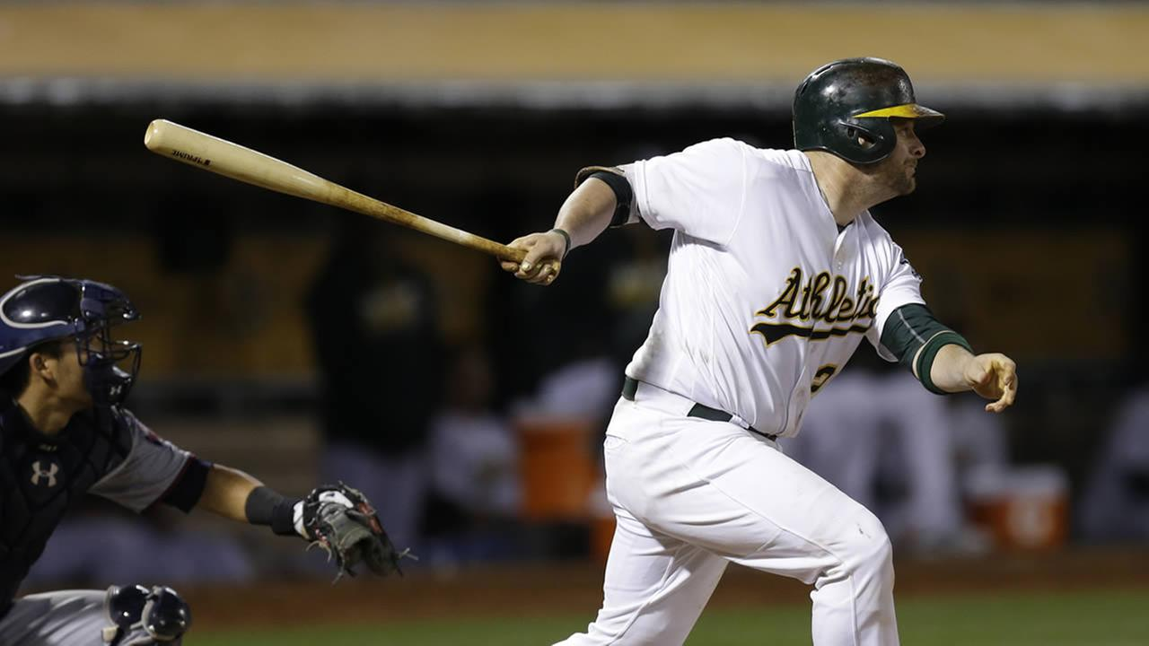 Athletics Stephen Vogt follows through on a two-run double off Twins Fernando Abad during a game Tuesday, May 31, 2016, in Oakland, Calif. (AP Photo/Ben Margot)