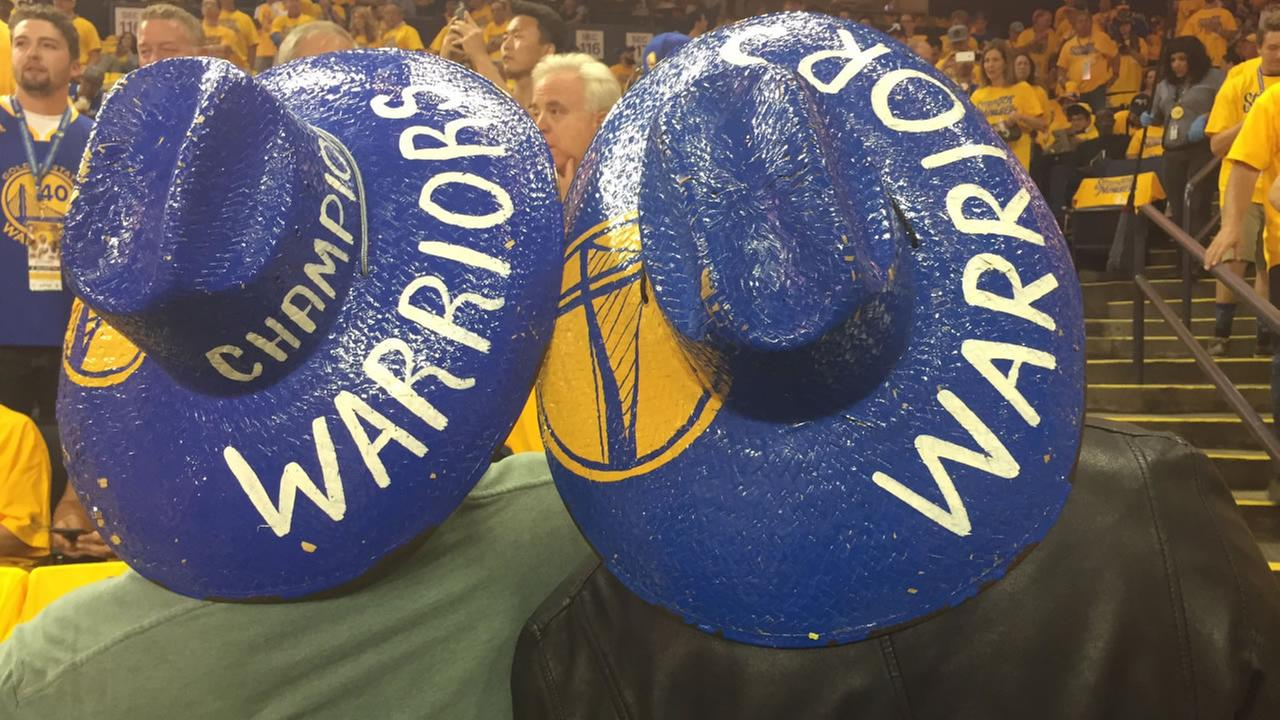 This image shows Golden State Warriors fans in matching hats on June 2, 2016.KGO-TV