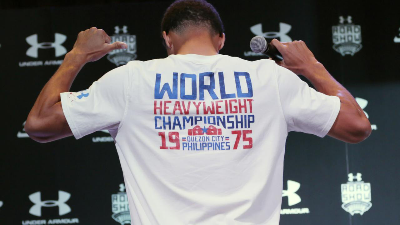 FILE: Stephen Curry shows off a Muhammad Ali t-shirt during a news conference upon on Saturday, Sept. 5, 2015 in the Philippines.