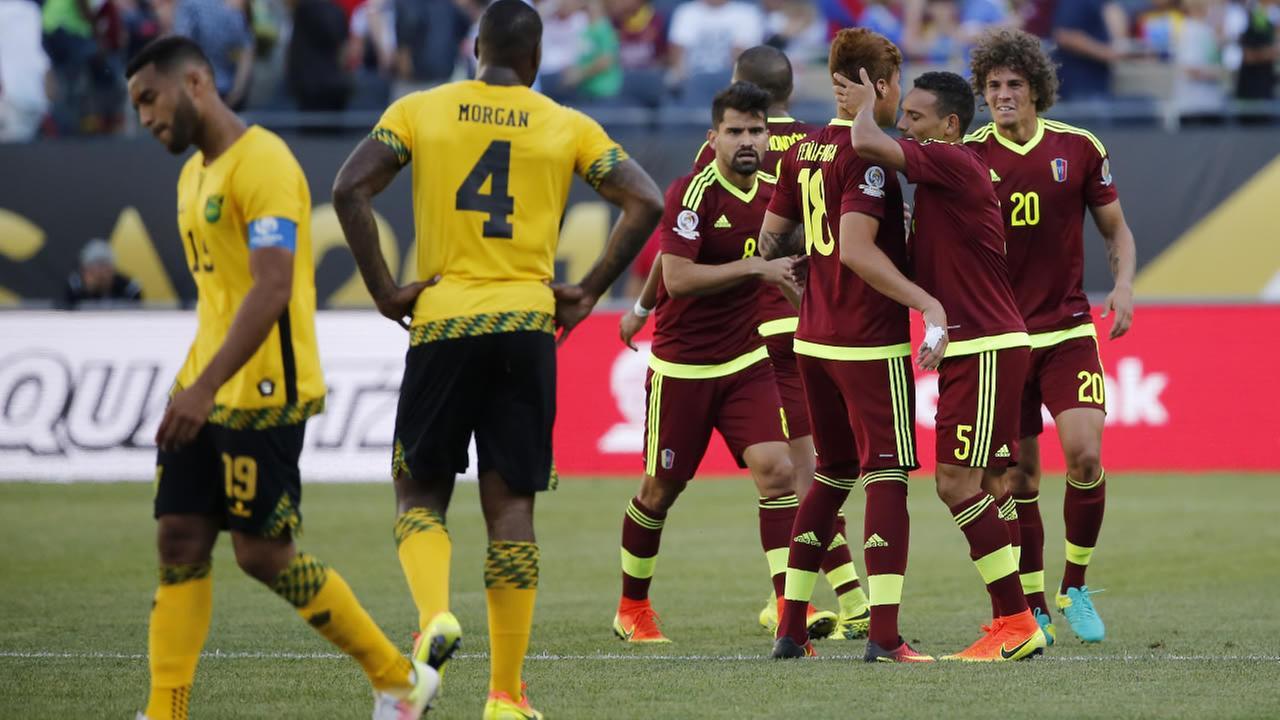 Venezuela players Adalberto Penaranda (18) and Arquimedes Figuera (5) celebrate a 1-0 win over Jamaica in a Copa America Centenario group C soccer match at Soldier Field in Chicago, Sunday, June 5, 2016.