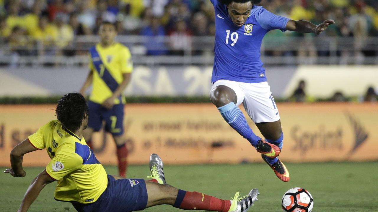 Brazils Willian, right, avoids a tackle from Ecuadors Arturo Mina during the second half of a Copa America Centenario Group B soccer match at the Rose Bowl, Saturday, June 4, 2016, in Pasadena, Calif.