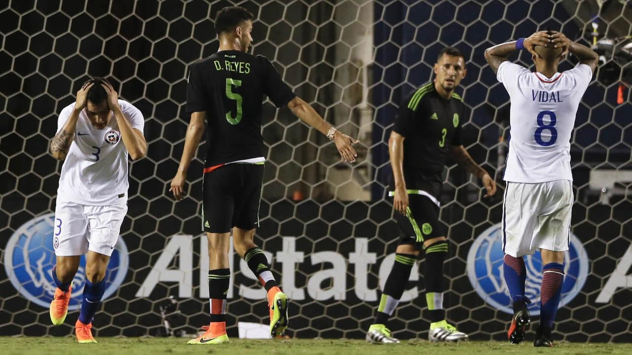 Chile defender Enzo Roco (3) and teammate midfielder Arturo Vidal (8) react after a missed shot on goal during the second half of a soccer game against Mexico Wednesday, June 1, 2016, in San Diego.