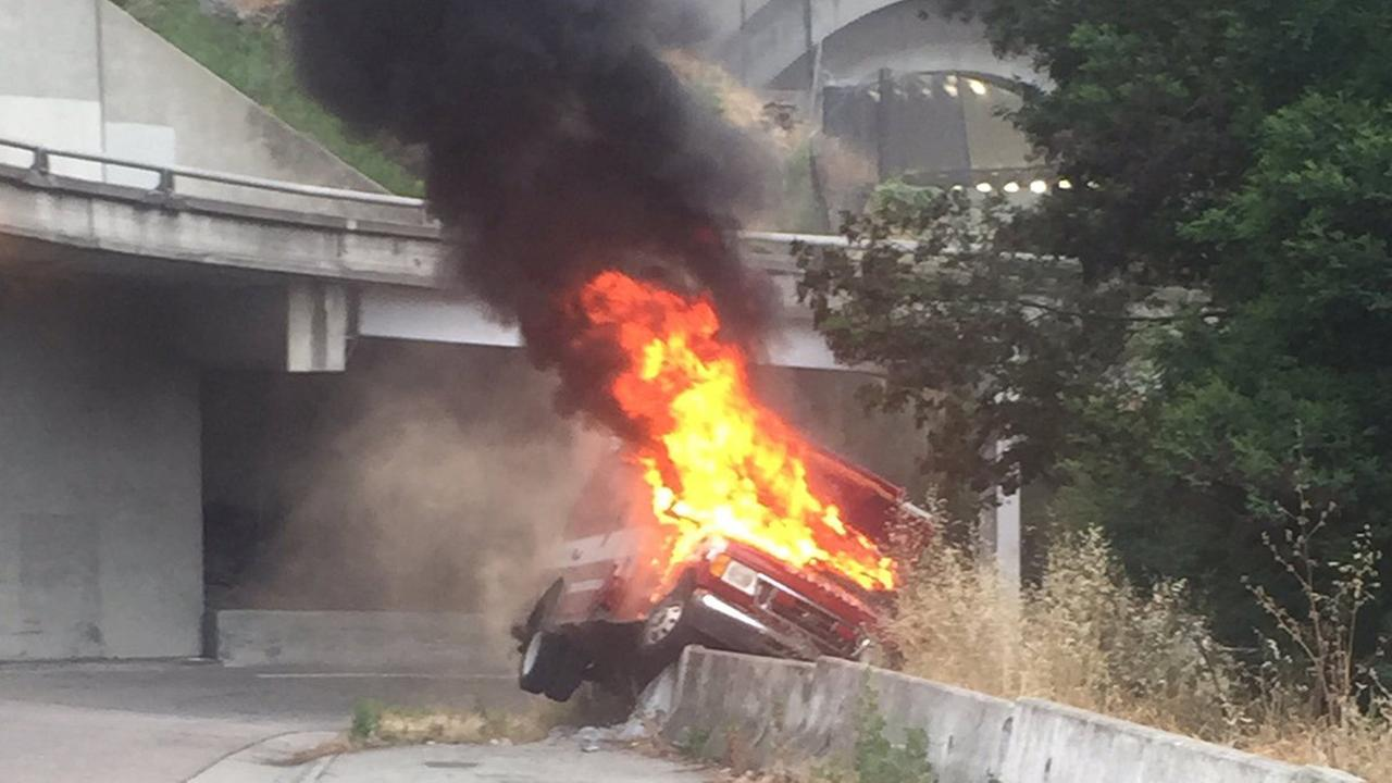An ambulance caught fire after police say they pursued it to the eastbound Treasure Island off ramp from the Bay Bridge, Tuesday, June 7, 2016.