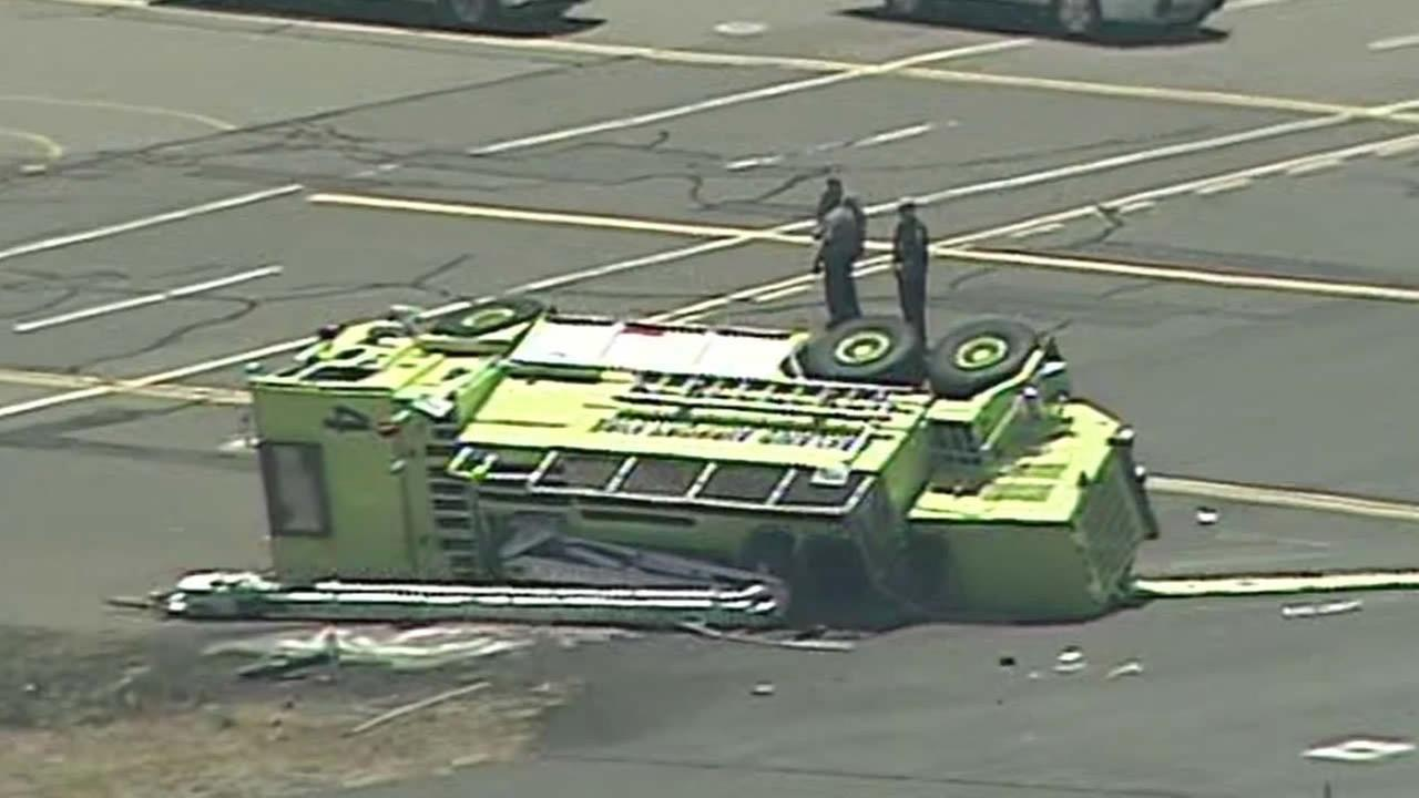 aircraft rescue firefighting rig flipped over at the Oakland International Airport