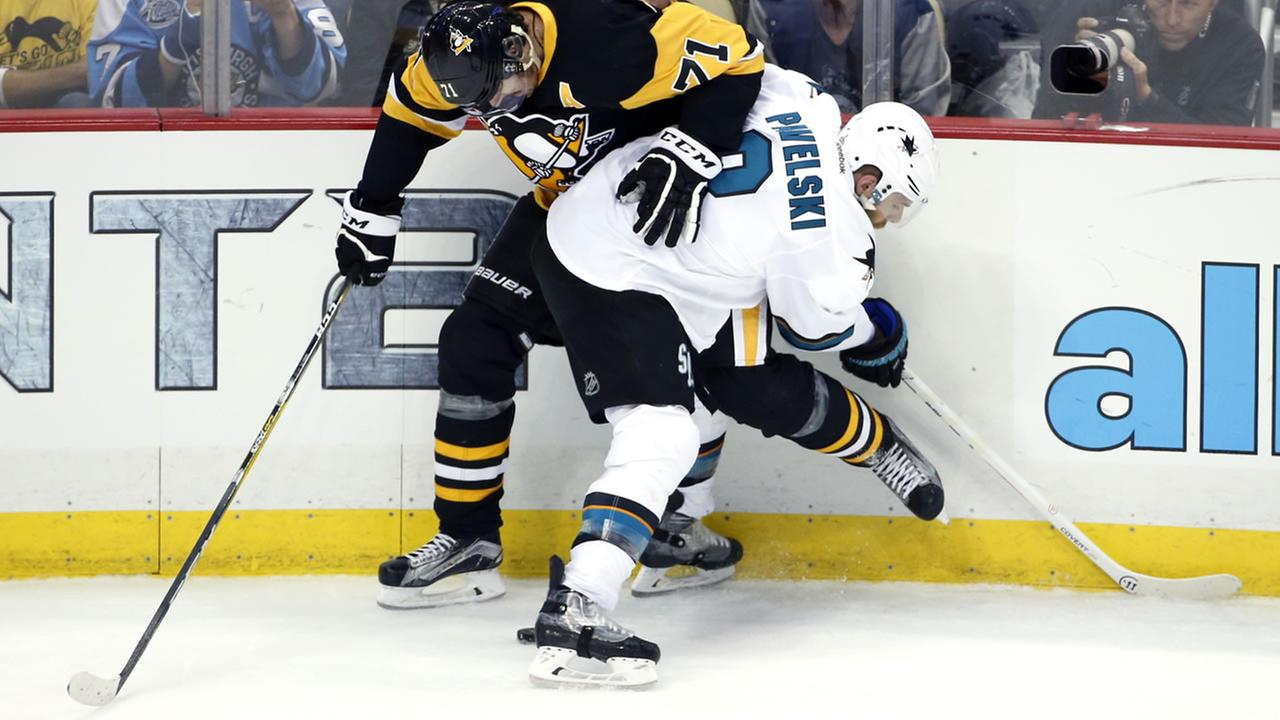 San Jose Sharks Joe Pavelski (8) checks Pittsburgh Penguins Evgeni Malkin (71) into the board in Game 5 of the NHL hockey Stanley Cup Finals on Thursday, June 9, 2016.