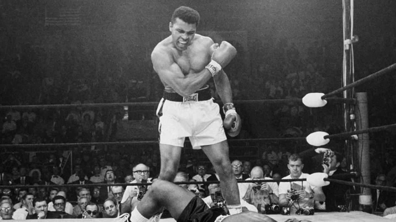 In this May 25, 1965, file photo, heavyweight champion Muhammad Ali, then known as Cassius Clay, stands over challenger Sonny Liston in Lewiston, Maine.