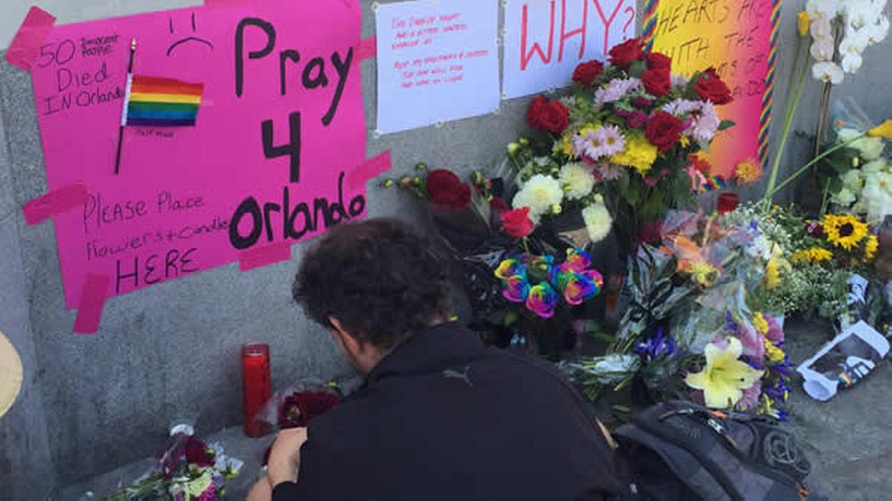 A memorial is growing in San Francisco to remember the victims of a mass shooting at a nightclub in Orlando, Florida on Sunday, June 12, 2016.