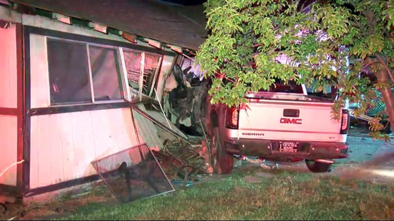 Truck crashes into home in San Jose, Tuesday, June 14, 2016.