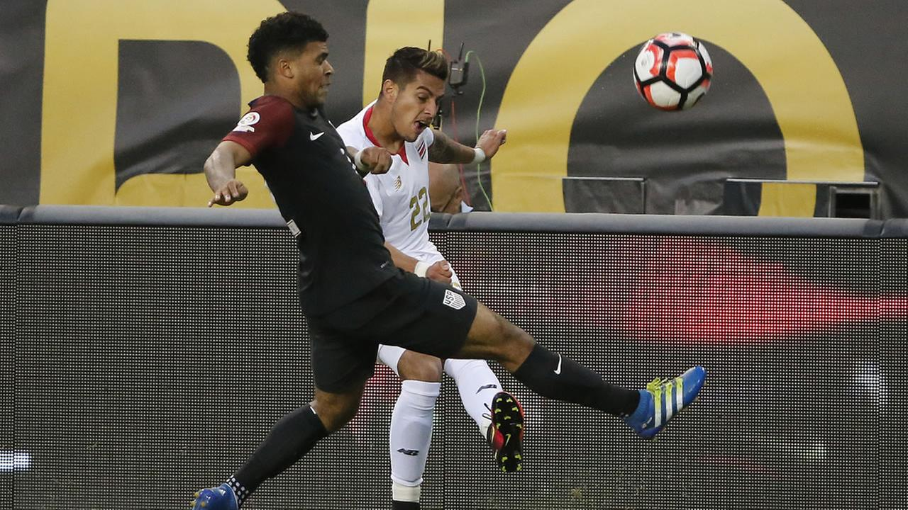 United States DeAndre Yedlin (2) and Costa Ricas Ronald Matarrita (22) battle during a Copa America Centenario group A soccer match at Soldier Field in Chicago,  June 7, 2016.