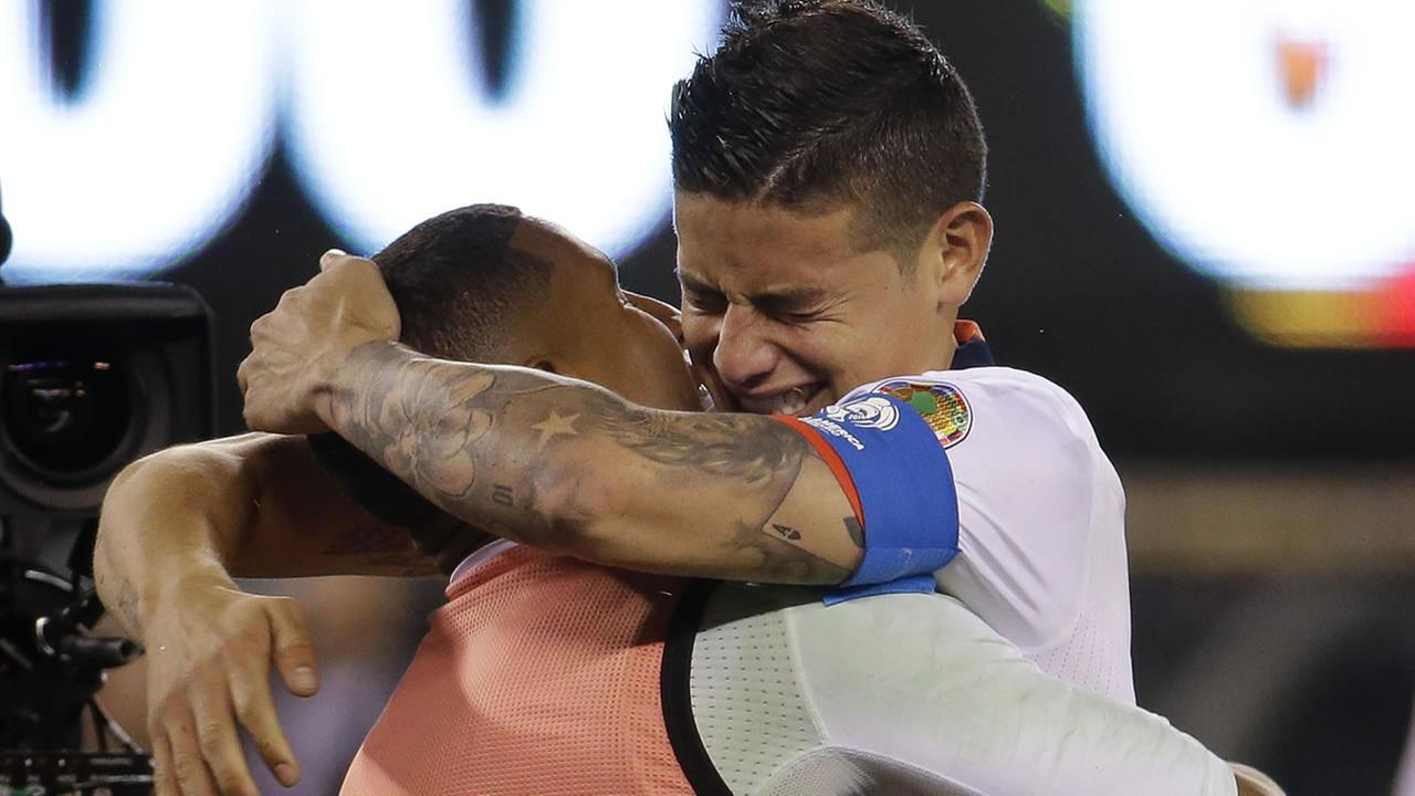 Colombias James Rodriguez, right, celebrates with goalkeeper Cristian Bonilla (23) after Colombia beat Peru in a penalty shootout of a Copa America quarterfinal soccer match.