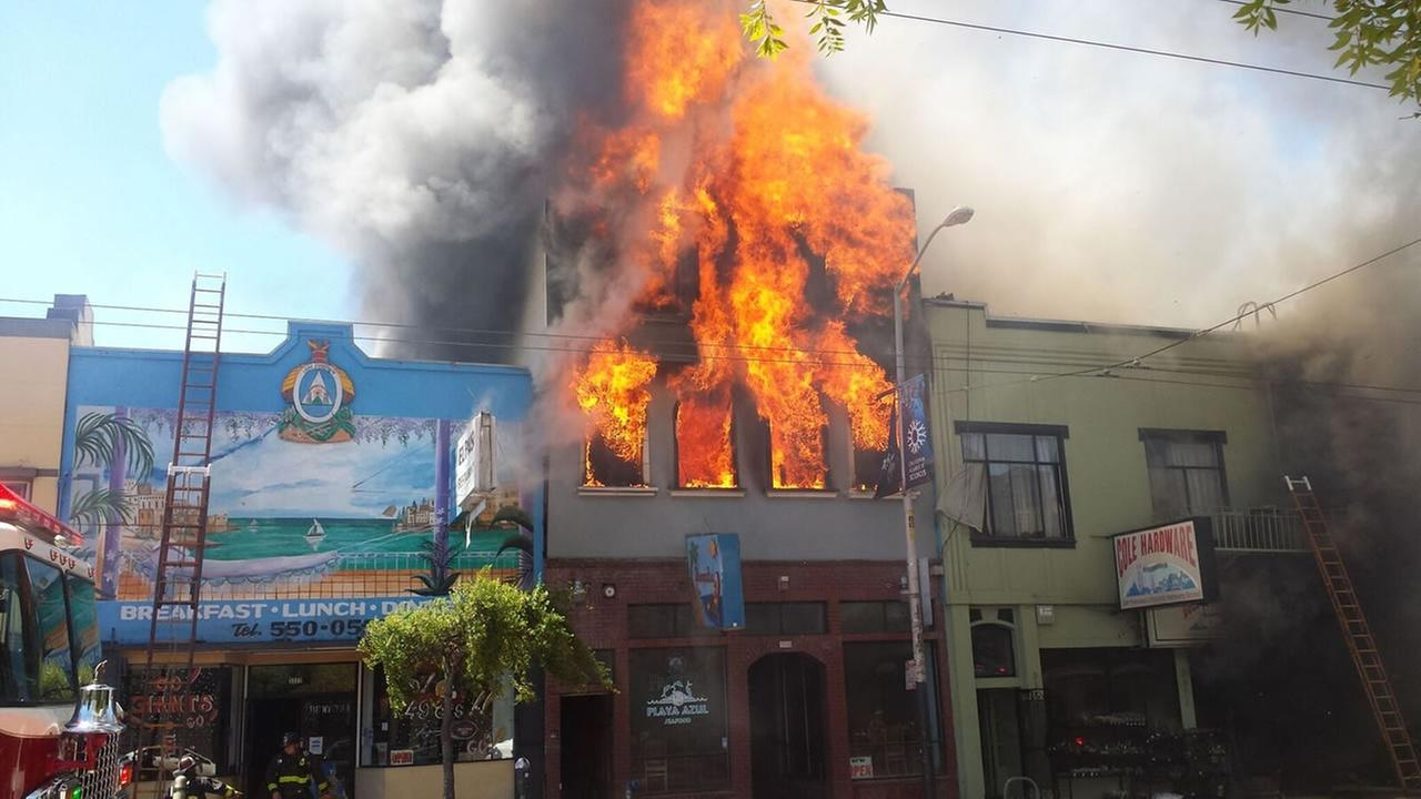 This image shows flames pouring out of a building on Mission and 29th streets in San Francisco on June 18, 2016.KGO-TV