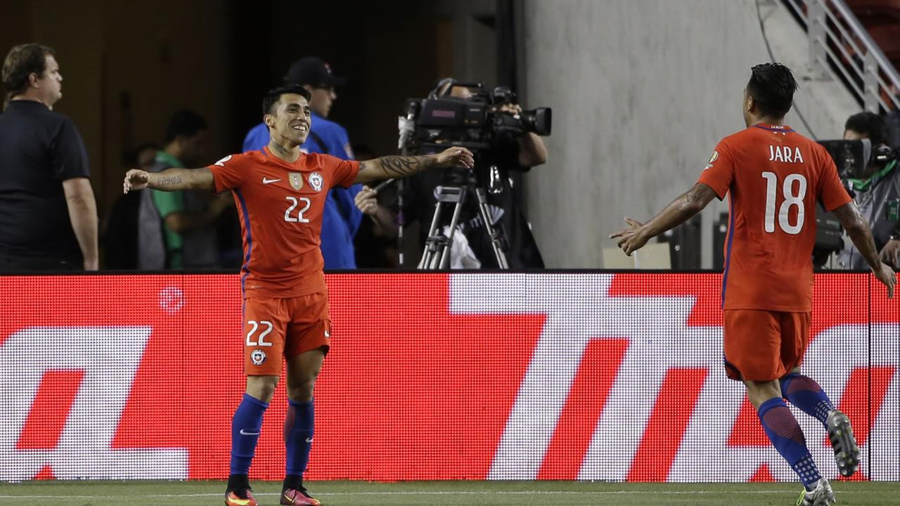 Chiles Edson Puch, right, celebrates after scoring against Mexico with his teammate Gonzalo Jara during a Copa America Centenario quarterfinal soccer match at Levis Stadium.