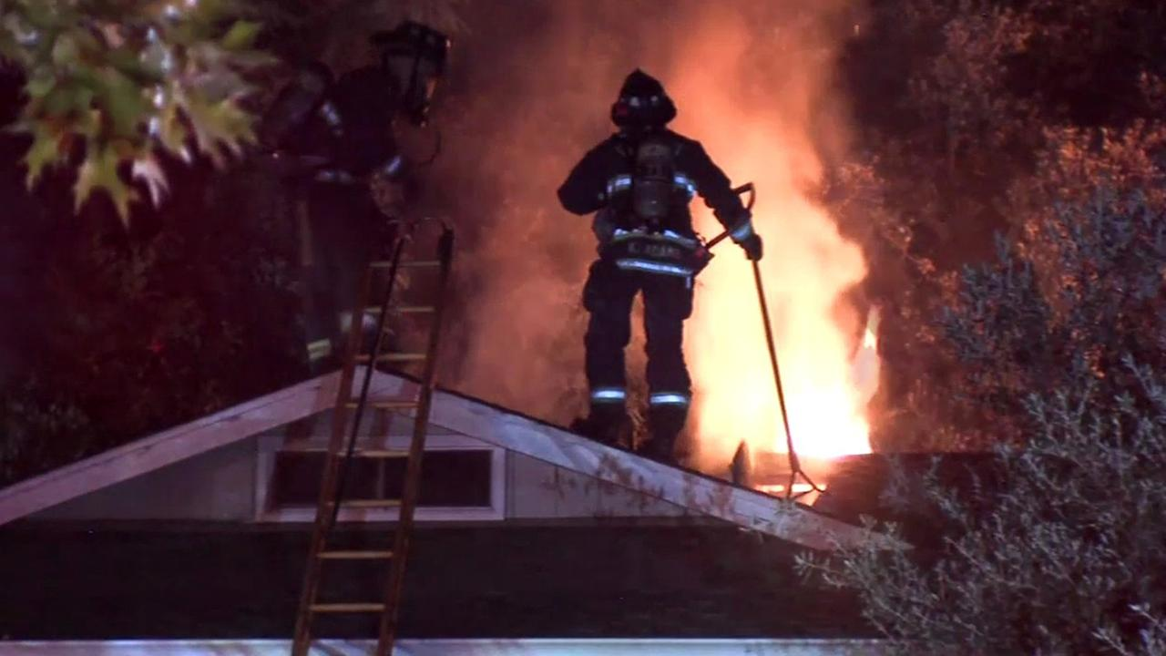 Firefighters fight house fire in Fremont, California, Tuesday, June 21, 2016.