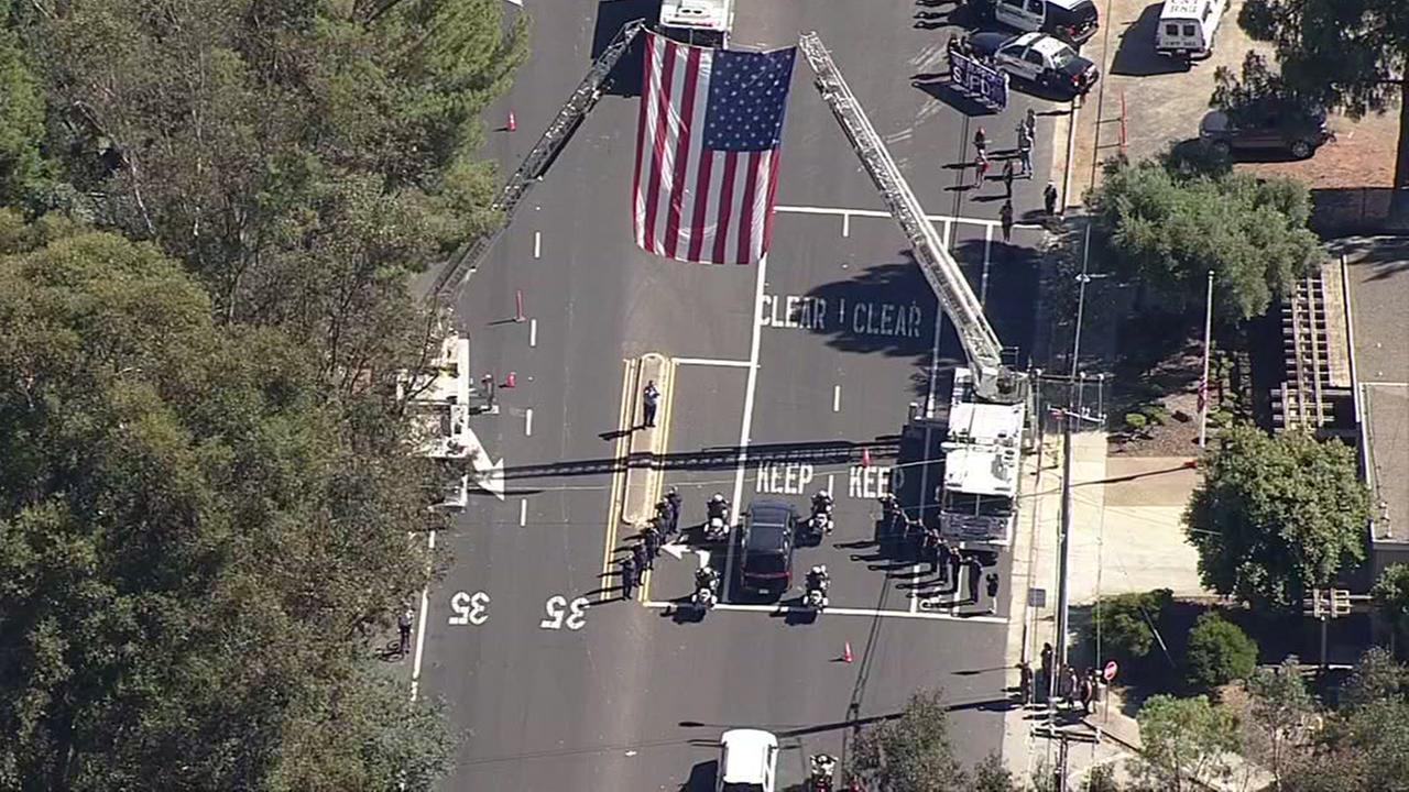 The body of SJPD Officer Michael Katherman is escorted from a funeral home in Los Gatos, Calif. to SAP Center in San Jose, Calif. on June 21, 2016.KGO-TV