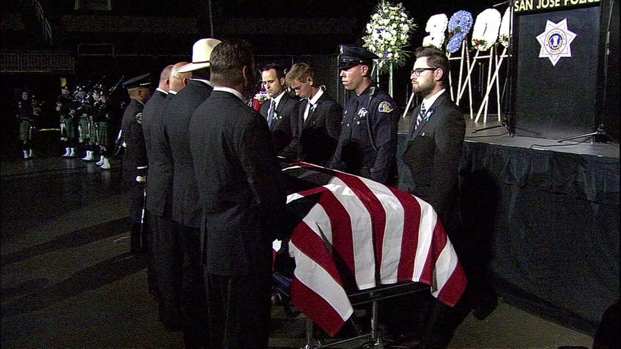 The body of fallen SJPD Officer Michael Katherman is brought into his public memorial service at SAP Center in San Jose, Calif. on Tuesday, June 21, 2016.KGO-TV